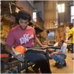 Young man glass blowing