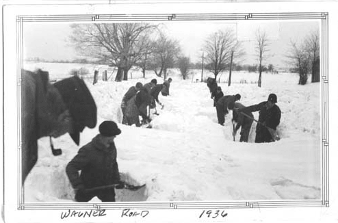 Men Shoveling Snow on Wagner Road